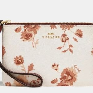 Coach Wristlet With Prairie Daisy cluster print